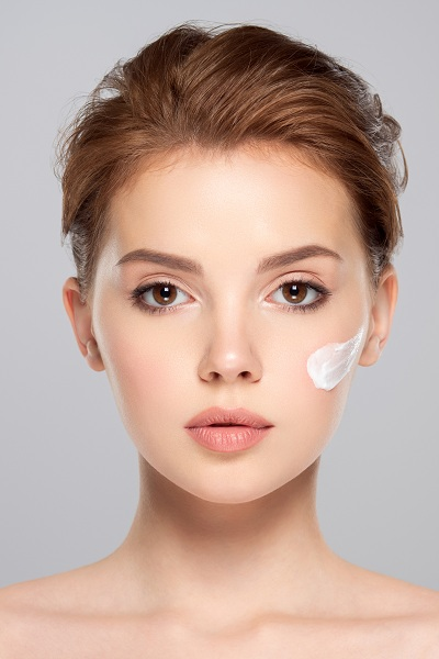 A cosmetic cream on a woman's face