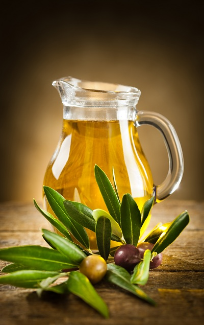 A pitcher of olive oil on the table