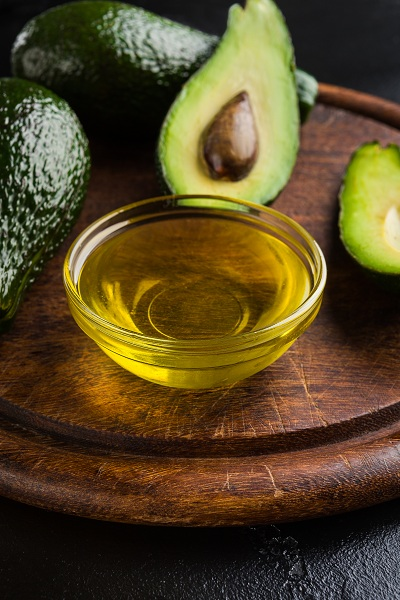 Avocado oil and fresh avocadoes