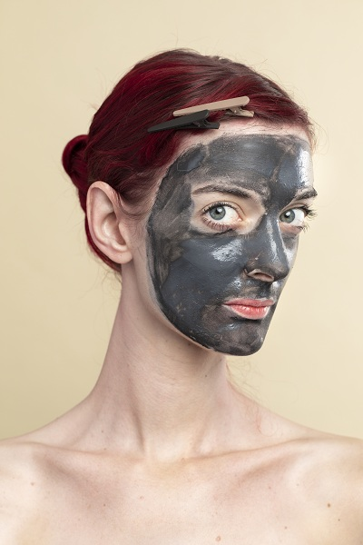 Black charcoal mask on a woman's face