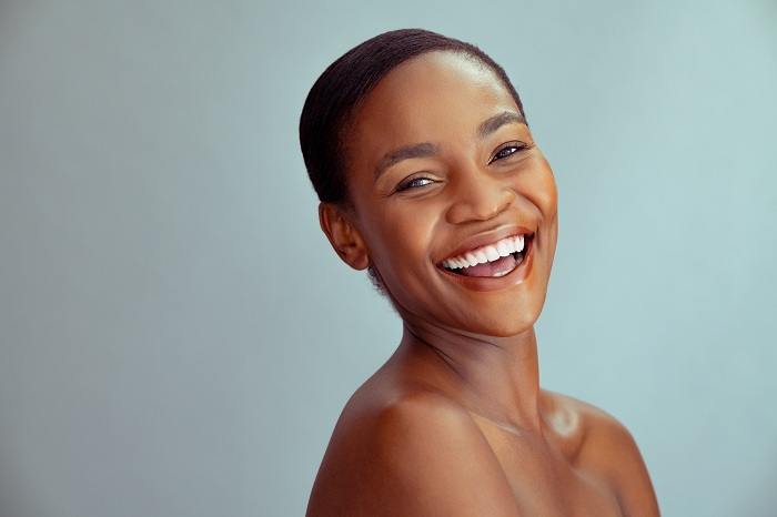 Cheerful black woman with healthy skin