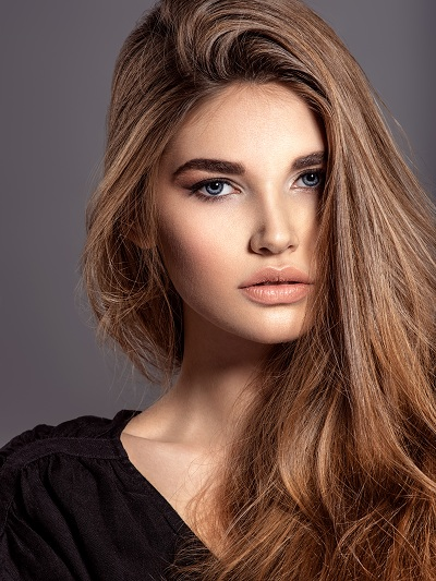 Pretty faced fashion model woman with brown hair