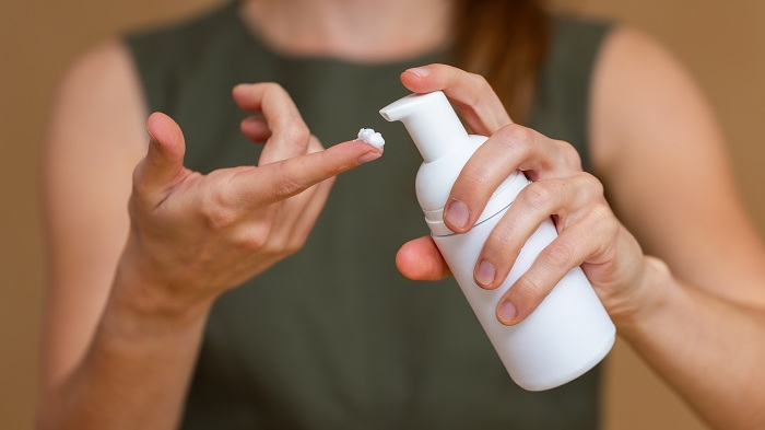 Woman about to use moisturizer