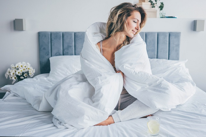 Woman on bed in the morning