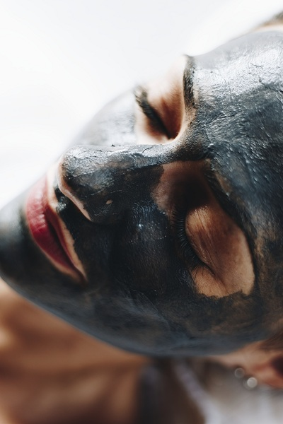 Woman on charcoal face mask