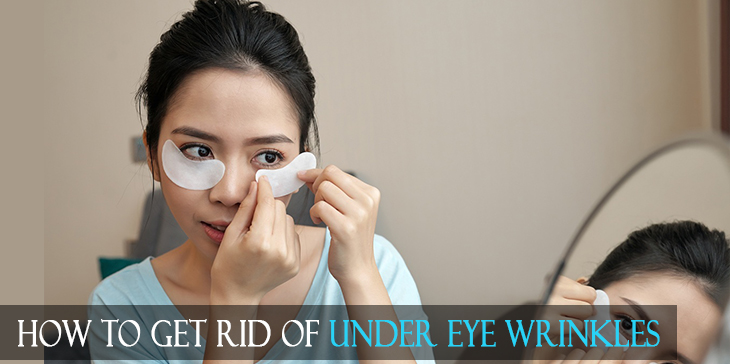 Woman putting eye patches for her under eye wrinkles