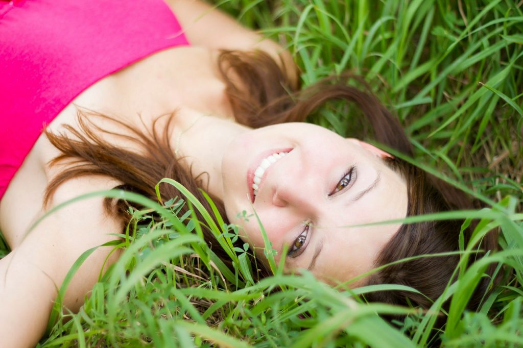Pretty woman laying on the grass