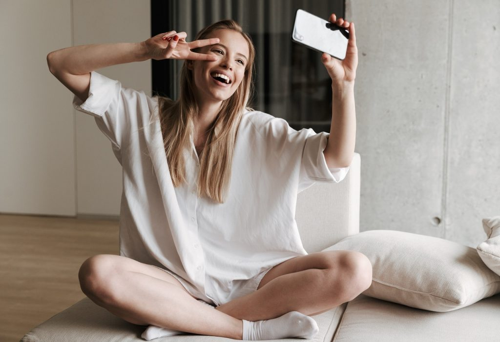woman with smooth skin having a selfie