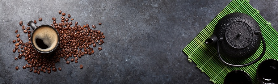 Coffee and tea on a dark colored table