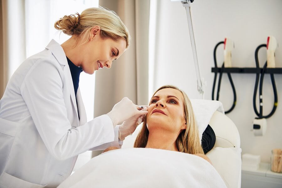 doctor doing botox injections on her patient