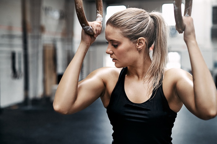 Fit young woman sweating during a gym workout