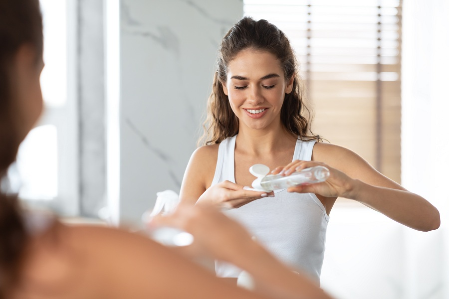 happy woman doing facial skincare