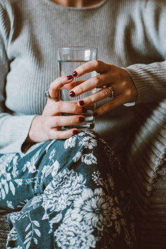 Middle aged lady holding a glass of water