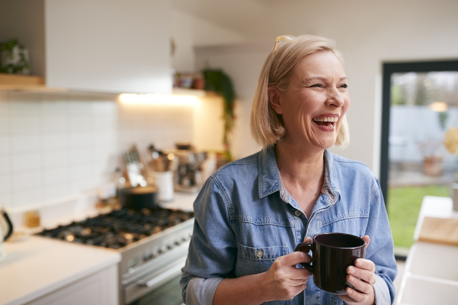 laughing mature woman at the kitchen