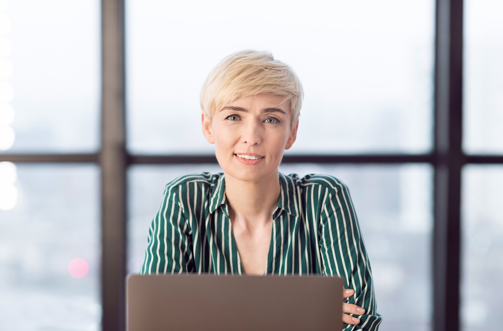 Mature Business Lady Sitting At Laptop In Modern Office