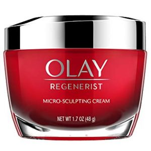 anti aging cream in a red tub