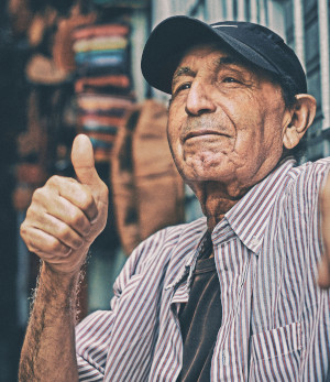 Old man giving thumbs up