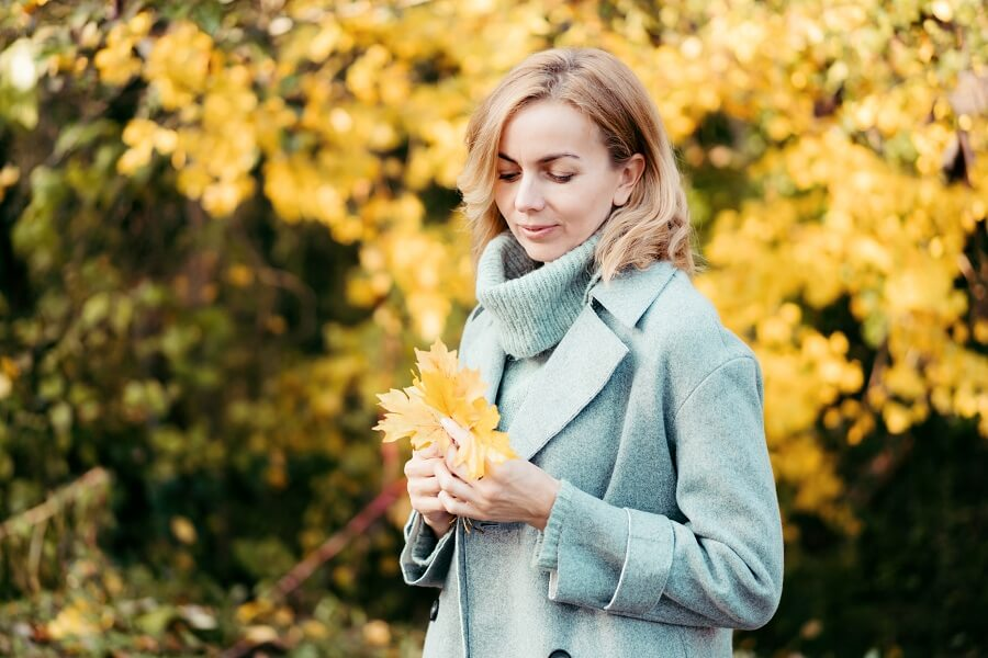 pretty middle aged woman in autumn season outdoors