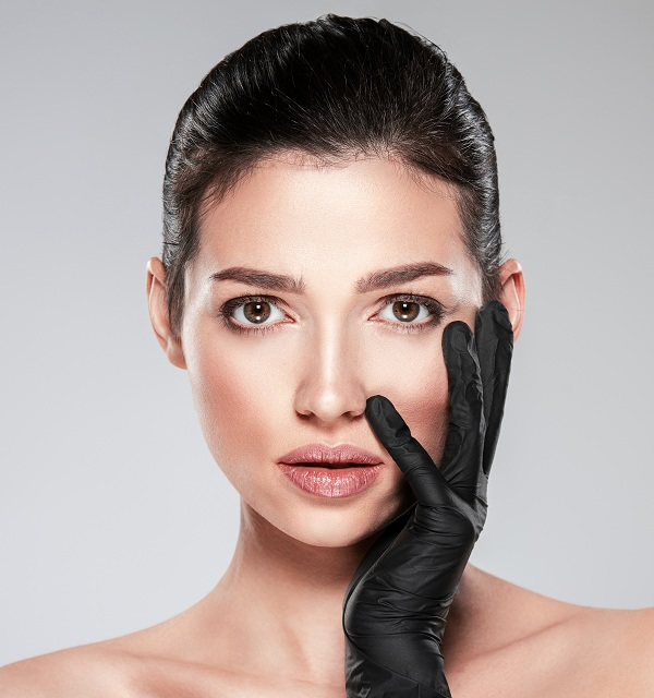 Woman is touching her face before plastic surgery