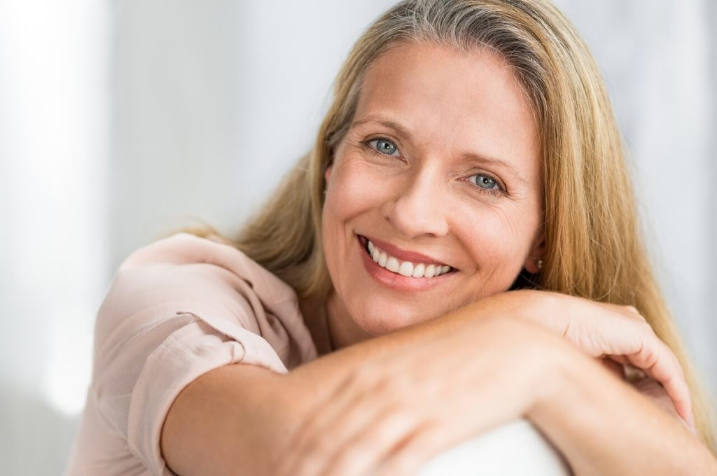 smiling mature woman on a couch