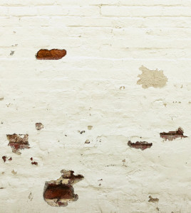 White wall with dark stains