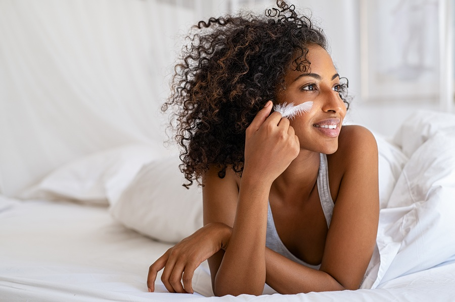 woman feeling her smooth and soft skin