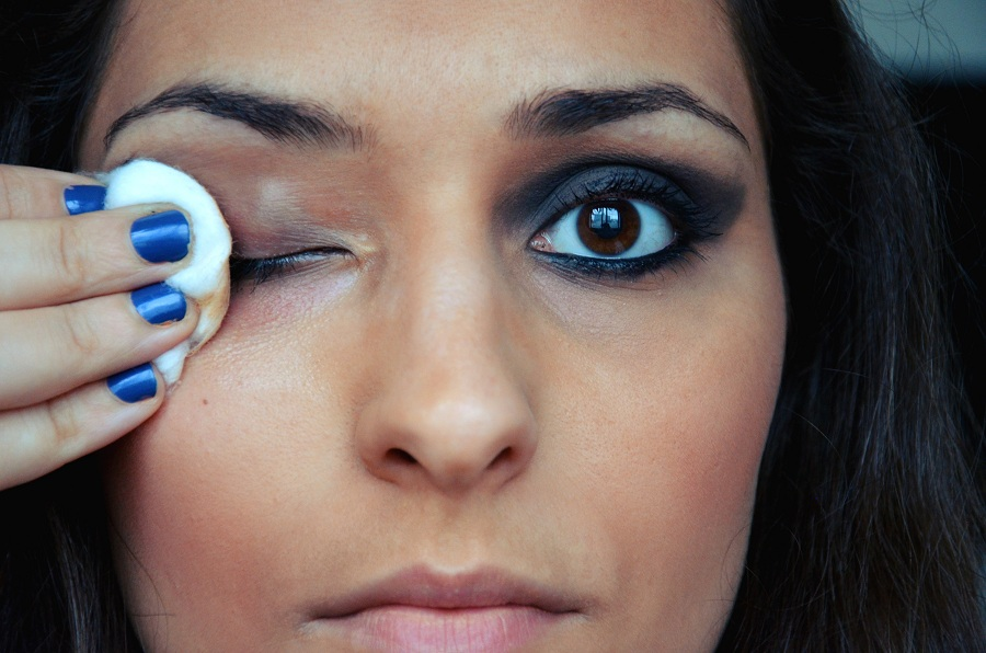 woman removing eye makeup before going to bed