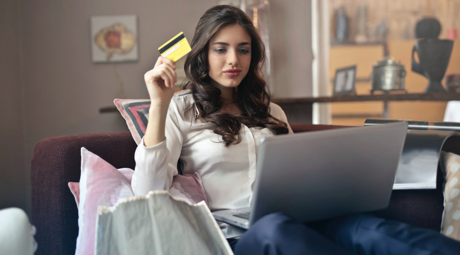 Woman holding back on her online shopping