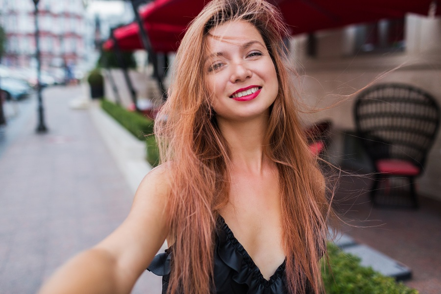 woman smiling being playful