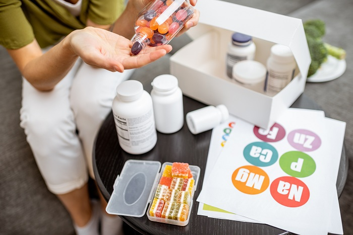 Woman taking vitamins or nutritional supplements