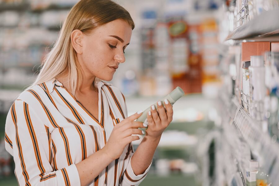 woman trying to buy skincare products from a pharmacy