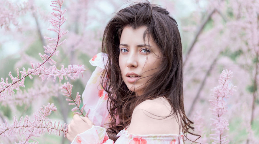 Woman surrounded by pink flowers