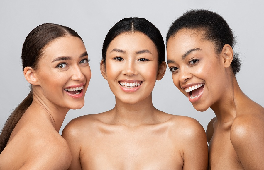 Women of different race smiling